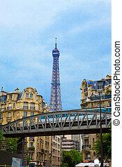 Paris. Bridge before building. Train of underground goes on bridge