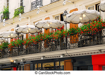 Paris cafe with a balcony patio and umbrellas