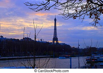 Paris city, France. Eiffel tower in early winter sunset.