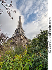 Paris. Eiffel Tower with vegetation and trees on a winter mornin