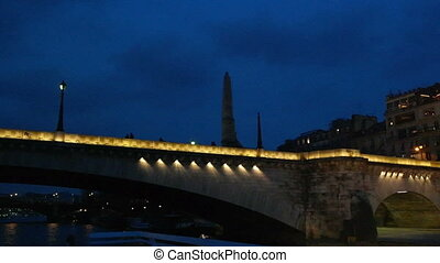 PARIS, FRANCE - 24 MARCH, 2016: Seine River cruise on boat tour. Vehicle shot in Paris, France. View from a boat floating under the bridge