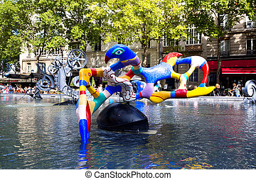 PARIS, FRANCE, August 6, 2014: Stravinsky Fountain (1983) is a fountain with 16 works of sculpture, August 6, 2014 in Paris. Sculptures spray water, representing works of composer Igor Stravinsky