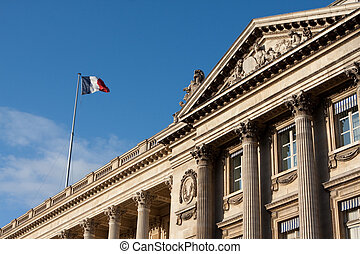 French flag flying in Paris, France on a national historic building along Champs Elysees