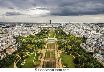 Paris, France - cityscape with Field of Mars gardens and Montparnasse skyscraper. UNESCO World Heritage Site.