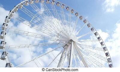 PARIS, FRANCE - MARCH 22, 2016: Ferris wheel (Roue de Paris) on the Place de la Concorde from the Tuileries Garden in Paris. Ferris wheel, originally installed on the Place de la Concorde in Paris