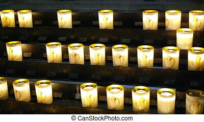 PARIS, FRANCE - MARCH 22, 2016:interior of Notre-Dame Cathedral in Paris. Religious candles burning in the shadows of the church