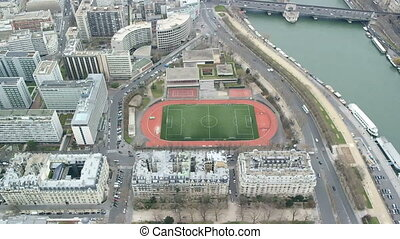 PARIS, FRANCE - MARCH 23, 2016: Aerial view of Paris cityscape, Seine river and stadium Emile Anthoine from the Eiffel Tower