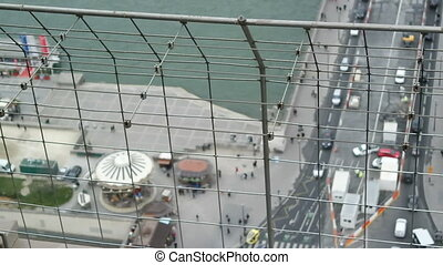 PARIS, FRANCE - MARCH 23, 2016: View from top of Eiffel Tower down to a busy intersection with cars and people in Paris, France
