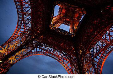 PARIS, FRANCE, SEPTEMBER 30, 2016: Eiffel Tower Light Beam Show at dusk. Closeup detail against the background of evening blue sky.