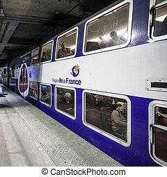 PARIS / FRANCE - SEPTEMBER 5th 2017: Platform of Paris Metro Station with train.