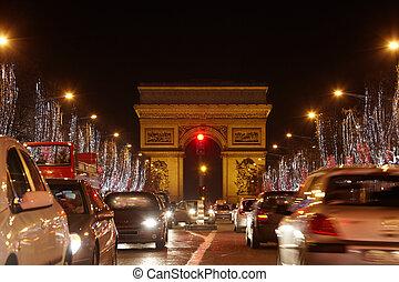 PARIS - JANUARY 1: Avenue des Champs Elysees and Triumph...