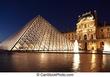 PARIS - JANUARY 1: View on the Louvre Pyramid and Pavillon Rishelieu in the evening, January 1, 2010, Paris, France. Pyramid weight — about 180 tons.