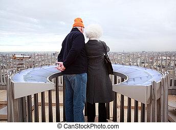 PARIS - JANUARY  2: Couple stands on Arc de Triomphe on January 2, 2010 in Paris, France. Annually Paris visits 20 million tourists.