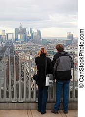 PARIS - JANUARY  2: Man and woman standing on Triumfaly arch and looking at La Defense on January 2, 2010 in Paris. La Defense is largest business center in Europe