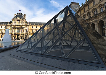 PARIS - March 20. Tourists enjoy the weather at the Louvre on Ma
