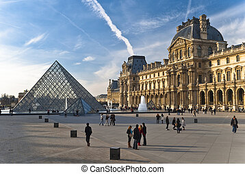 PARIS - March 20. Tourists enjoy the weather at the Louvre...