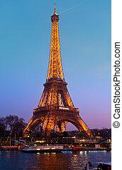 PARIS - MARCH 31: Eiffel Tower in festive illumination to ...