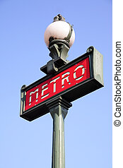 Paris metro sign and sky in the background