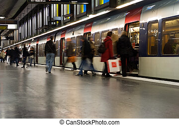 Paris Metro Stop - Busy weekend commuters board an RER...