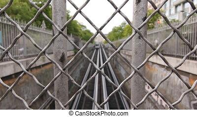 Paris metro train through fence.