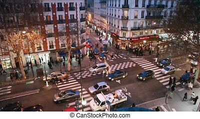 Paris night street traffic, view from above crossroads
