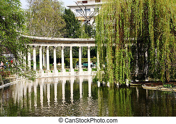 The lake in the Park Monceau with reflections of the onrnimental corinthian pillars