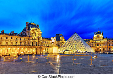 PARIS - SEPTEMBER 17. Glass pyramid and the Louvre museum on...