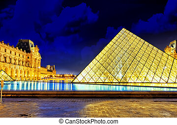 PARIS - SEPTEMBER 17. Glass pyramid and the Louvre museum on September, 17, 2013. The Louvre is the biggest museum in Paris with nearly 35,000 objects from prehistory to the 19th century .