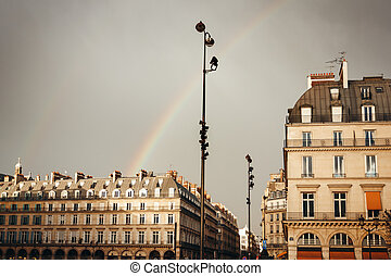 Paris Street View with Rainbow in the Sky After Rain