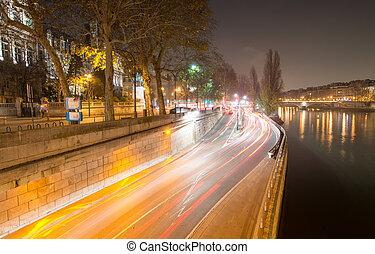 Paris streets along Seine river at night