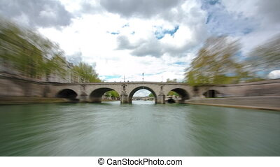 Paris. The excursion motor ship floats down the river Seine in the cloudy spring day timelapse