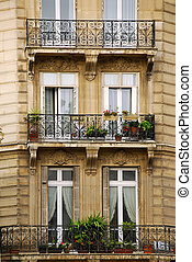 Windows and balconies of old apartment buildings in Paris France