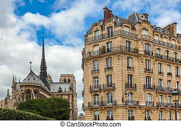Parisian building and Notre Dame de Paris Cathedral. - View...