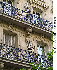 Wrought iron railings and burglary deterrents on buildings in Paris