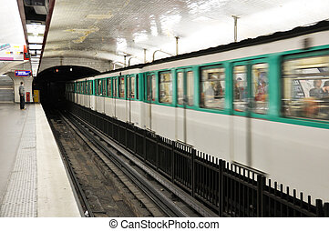 Parisian metro arriving in a station