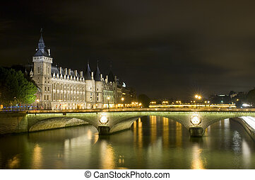 Parisian Nights - A nightly view over the river Seine in...