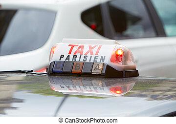 Parisian taxi sign in Paris