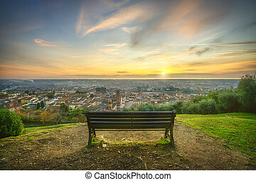 Park bench and Pietrasanta aerial view at sunset, Versilia Lucca Tuscany Italy