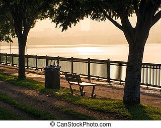 Park bench at rivers' edge