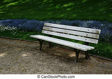 Park bench on the garden bed