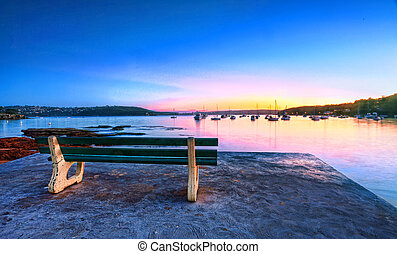 Park bench with a seascape view sunrise