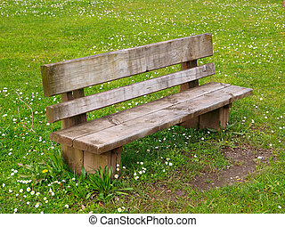 Park bench - Wooden park bench in nature. A good place to ...