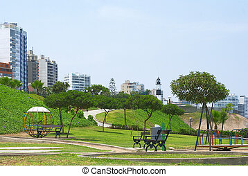 Park in Lima, Peru - Park and residential buildings on the...