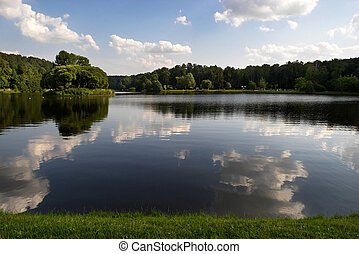 Park landscape - A view to a beautiful pond with the ...