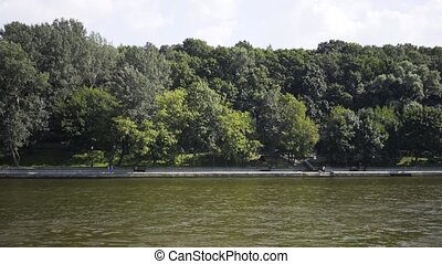 Park on the bank of the Moskva river on a summer day shot...