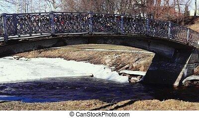 Park river bridge panning in spring