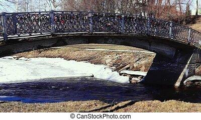 Park river footbridge in spring