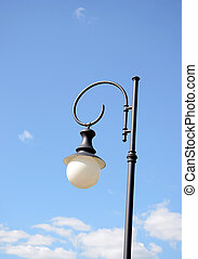 Park round light lamp on pole on background of sky