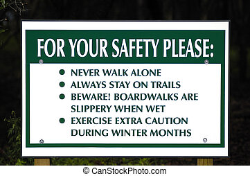 Park Safety Sign - A nature trail park sign giving advice.