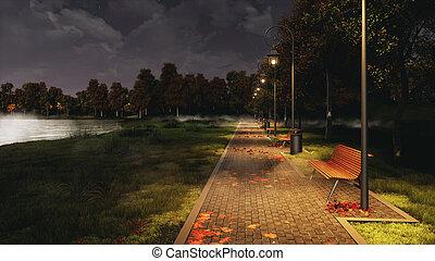 Park walkway lit by street lights at autumn night